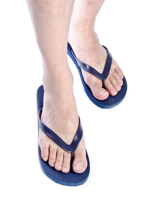 flip flops: Men Wearing Navy Blue Flip Flops on White Background