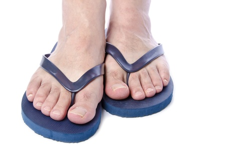 Men Wearing Navy Blue Flip Flops on White Background photo