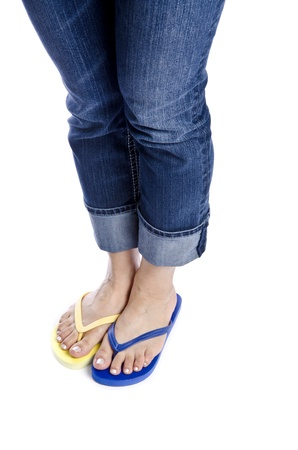 flip flops: Woman Wearing Mismatched Flip Flops Isolated on White Stock Photo