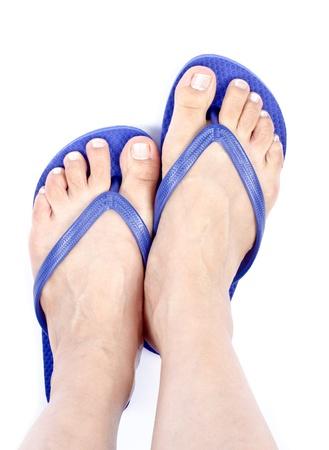 flops: Bare Feet and Blue Flip Flops