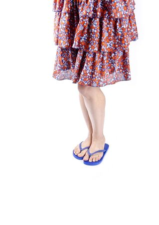 Woman Wearing Blue Flip Flops and Floral Skirt photo