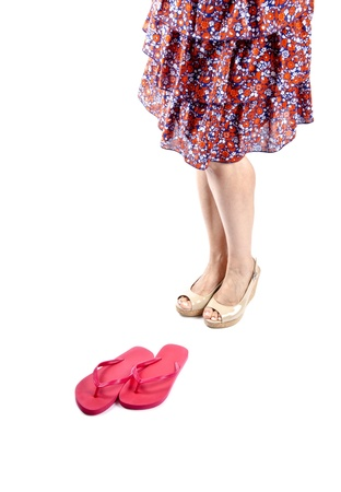 Woman Wearing Platform Sandals and Floral Skirt photo