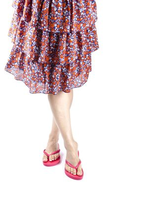 Woman Wearing Pink Flip Flops and Floral Skirt photo