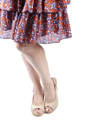 Woman Wearing Plateau Sandalen und Floral Skirt photo