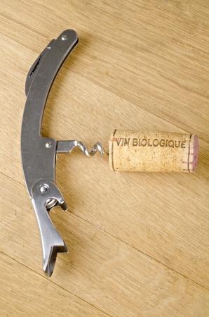 vin: Cork Labelled Vin Biologique in a Corkscrew