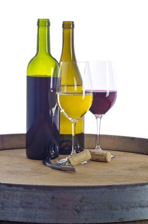 oak barrel: Bottles and Glasses Filled with Red and White Wine on Top  of an Oak Barrel