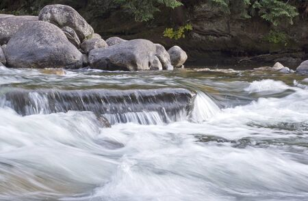 Flowing River Over Rocks