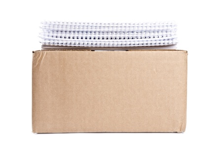 Cardboard Box with Stack of Calendars on Top