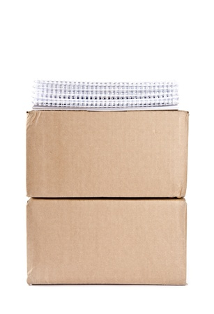 Cardboard Boxes with Stack of Calendars on Top