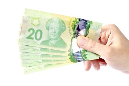 plastic money: Hand Holding Canadian Twenty Dollar Bills Stock Photo