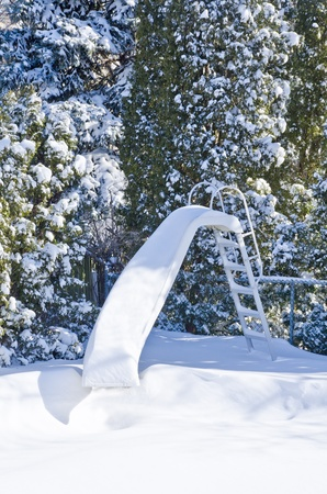 Water Slide by the Pool Covered with Snow