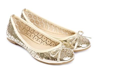 zapatillas ballet: Oro Zapatillas de ballet aislado en blanco