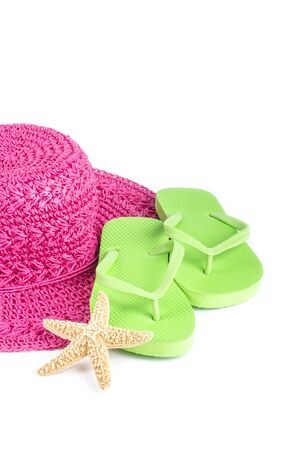 flops: Pink Straw Hat and Lime Green Flip Flops Isolated on White
