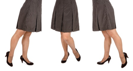 Woman Wearing Polka Dot Mini Skirt and Black Suede Pumps Isolated  Stock Photo
