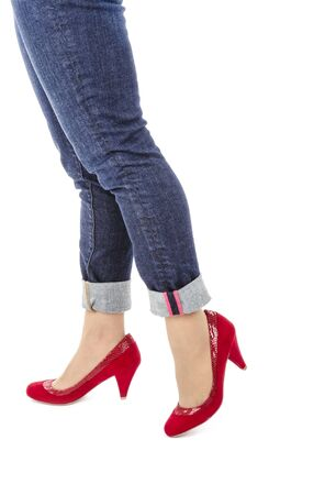 capri pants: Woman Wearing Capri Blue Jeans and Red Suede Pumps Isolated on White