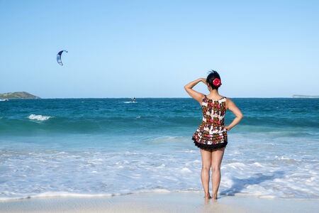 Woman with Sun Dress Looking Out to the Caribbean Sea  Stock Photo - 24736533