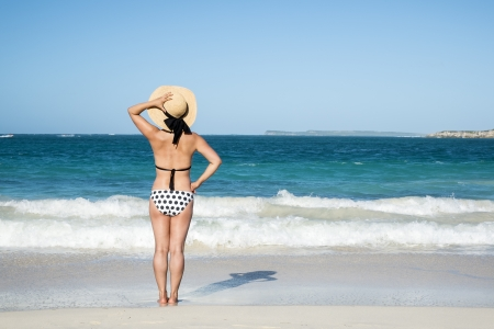 Woman with Polka Dot Bikini Looking Out to the Caribbean Sea  Stock Photo - 24736536