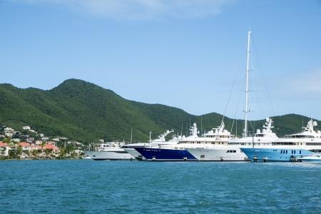 anchored: Big Yachts Anchored at a Bay in the Caribbean