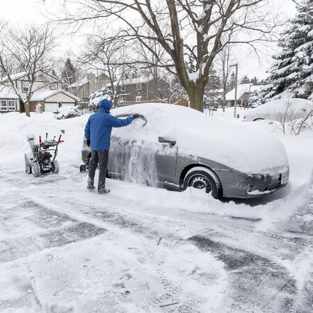 snow clearing: Man Clearing Snow Off the Car Window