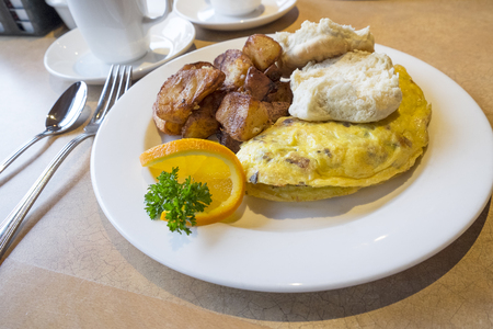 Omelette Served with Biscuits and Roasted Potatoes photo