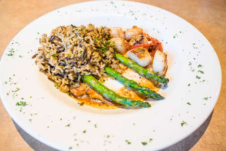 Pan Seared Scallops Served with Asparagus and Wild Rice