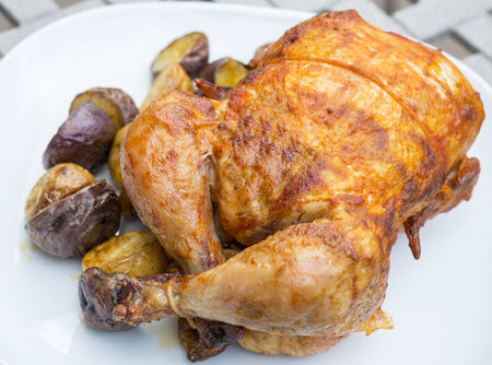 Rotisserie Chicken Served with Small Roasted Potatoes