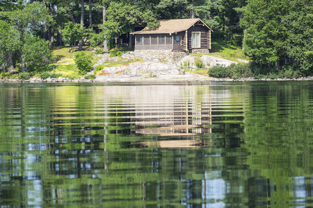 lake dwelling: Cottage on a Tranquil Lake