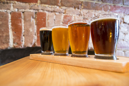 Flight of Four Beers for Tasting in a Pub