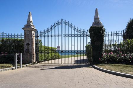 Black Iron Gate Against Blue Sky
