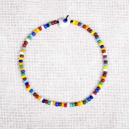 choker: Colorul Bead Choker Necklace Over Textured Paper