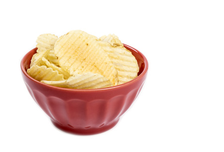 ruffle: Red Bowl of Ruffle Potato Chips Isolated on White