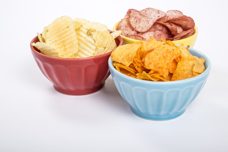 ruffle: hree Colorful Bowls of Potato Chips of Various Flavors