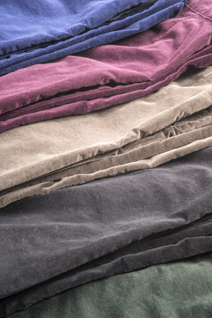 stretchy: Closeup of Womens Velvet Pants in Assortment of Colors Stock Photo