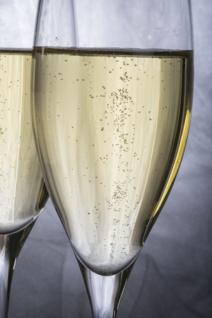 wine glasses: Closeup of Two Glasses of Champagne on Grey Background Stock Photo