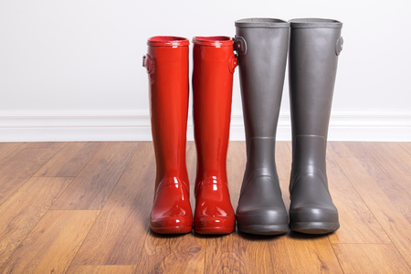 rubber boots: Womens and Mens Rubber Boots Stock Photo