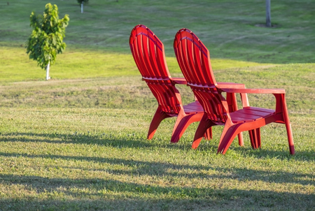 adirondack: Two Red Adirondack Chairs on the Lawn