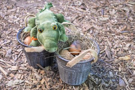 brown eggs: Stuffed Alligator Guarding Freshly Laid Brown Eggs Stock Photo