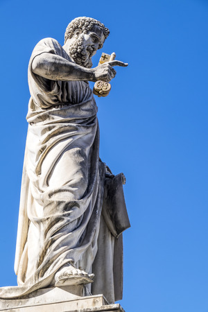 Saint Peters Statue Holding Golden Key to Heaven in St. Peters Square in Vatican City