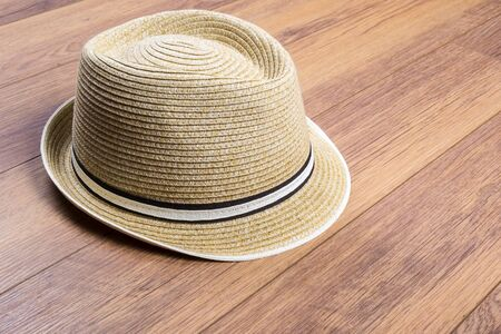 Straw Hat on Laminated Flooring