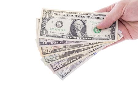 白で隔離様々 な宗派に米ドル紙幣を持っている手