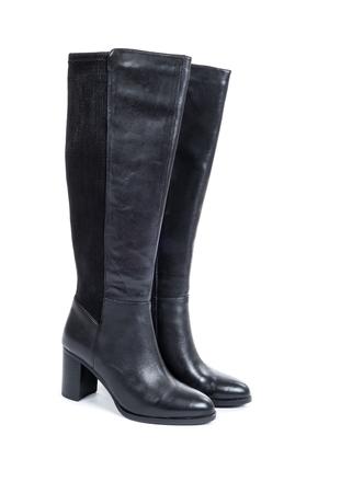 女性の膝ハイブラックレザーブーツは、ホワイトに隔離