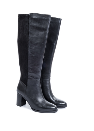 Women's Knee High Black Leather Boots Isolated on White Banque d'images