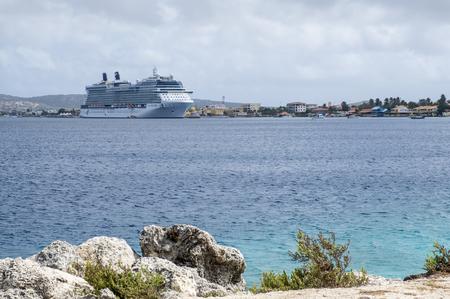 Kralendijk, Bonaire - April 12, 2018: View of Celebrity Equinox Cruise Ship docked in Kralendijk from Te Amo Beach Editorial