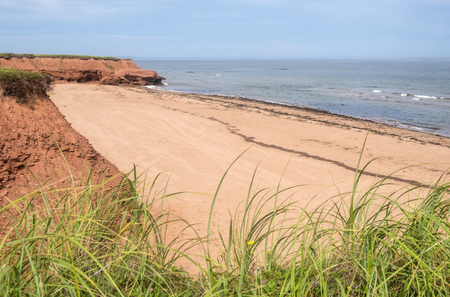 The Tranquil Red Sand Beach of Thunder Cove in Prince Edward Island Canada Reklamní fotografie
