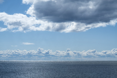 Dramatic Clouds Over the Shimmering Sea