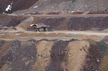 dug: Large mining truck carrying ore across an open pit mine Stock Photo