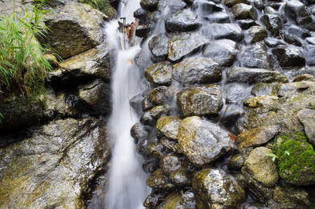Water flowing over rocks Stock Photo - 24096372