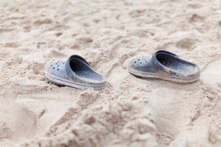 Flipflops on a sandy ocean beach - summer vacation concept Stock Photo - 24136455