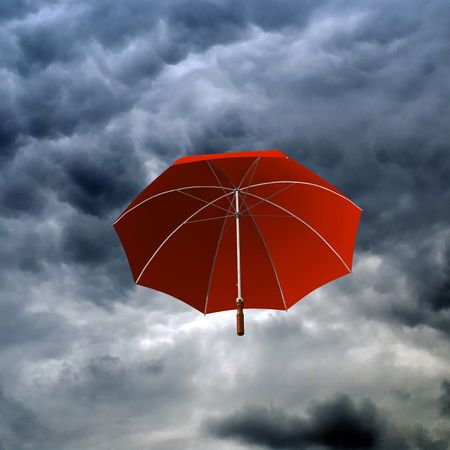 RED UMBRELLA IN THE CLOUDY DAY Stock Photo