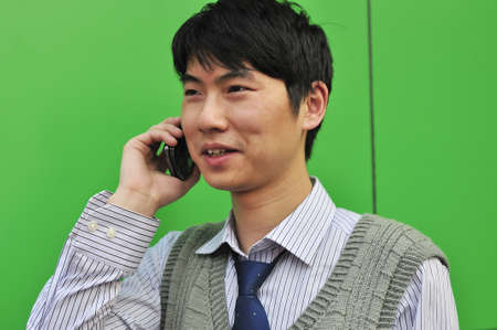 asian young businessman using mobile phone,outdoors  photo